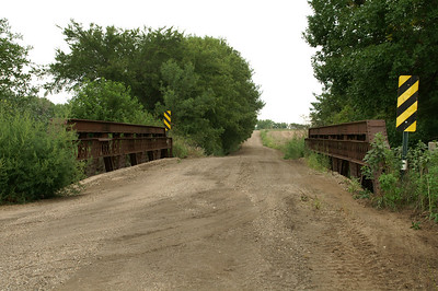 Pony truss bridge over Little Arkansas River on 23rd Rd