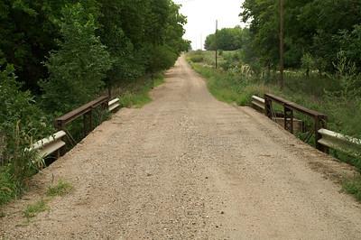 Pony truss bridge over Little Arkansas River on 21st Rd