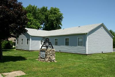 Community Center building in Lone Elm. Also former Methodist Church bell.