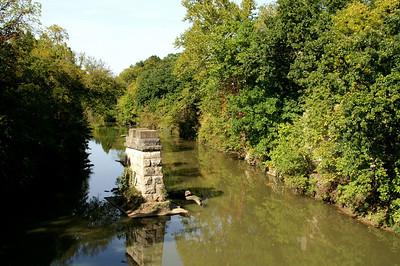 Abandoned railroad bridge pier in Cedar Creek east of Elgin