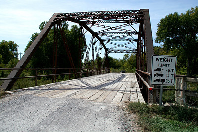 Iron truss bridge over Otter Creek north of Cedar Vale. Built 1936 by WPA.