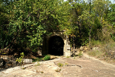 Abandoned railroad stone arch bridge along Rd 11 near Caney River
