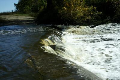 Water flowing over Cherry Creek low water bridge - western Cherokee County