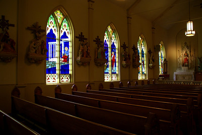 Stained glass and sanctuary in St Bridget's Catholic church in Scammon