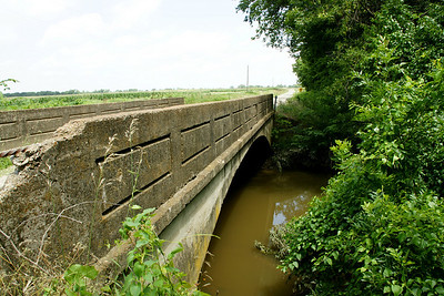 Concrete arch bridge over branch of Hickory Creek near McCune