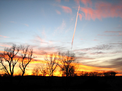 Sunset and jet contrail in Sallyards area - western Greenwood County