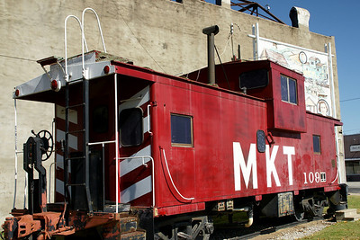 MKT caboose in downtown Oswego. Note: building and mural behind are no longer present.