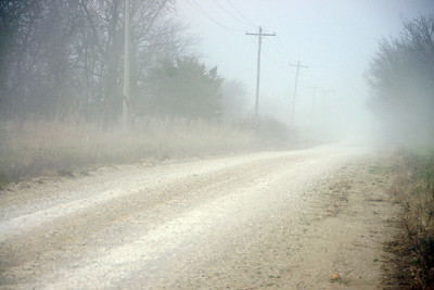 Gravel dust in the air along rural - road western Linn County