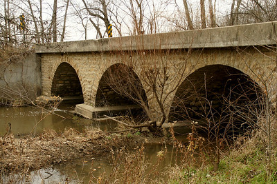 Triple stone arch bridge with concrete deck over East Laberdie Creek southwest of Prescott
