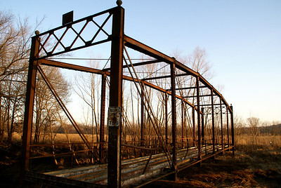 Elegant iron thru truss bridge over Onion Creek near Coffeyville. Built in 1911.