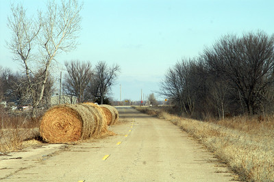 Section of old US-169 at Earlton with hay bales on the road