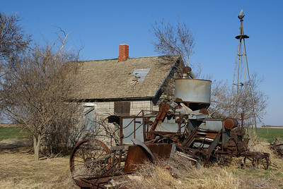Abandoned house and combine southwest of Lewis