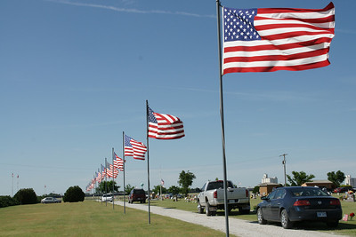 Flags at Dudley Township Cemetery near Satanta