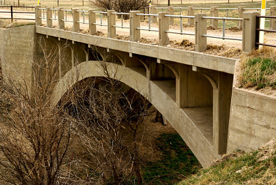 Elegant concrete arch bridge over Hackberry Creek - northwest Hodgeman County