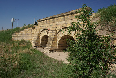 Double masonry stone arch bridge over branch of Wild Horse Creek - northern Ness County