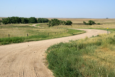 Road winding thru North Fork Walnut Creek valley - western Ness County
