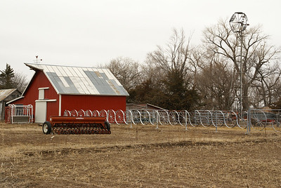 Windmill, Red barn, and wagon wheel fence