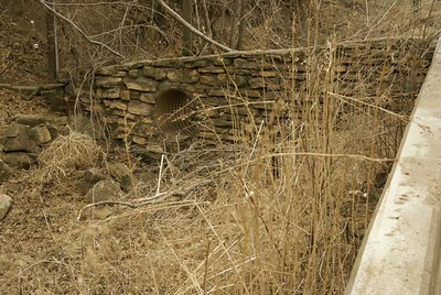 Limestone bridge extension thru ditch near creek