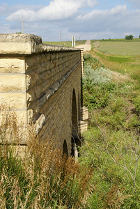 Rush / Russell County line triple masonry arch bridge