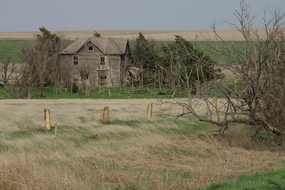 Abandoned house and post rock fence - SW Rush County
