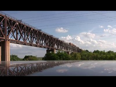 UP train crossing Samson bridge over Cimmaron River. Reflection of bridge in my truck roof where camcorder was sitting.