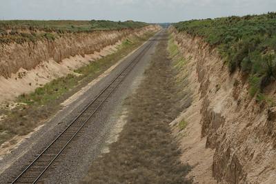 UP railroad running thru cut near Cimmaron River