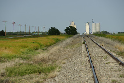 Looking east along railroad tracks to the grain elevators in Manter