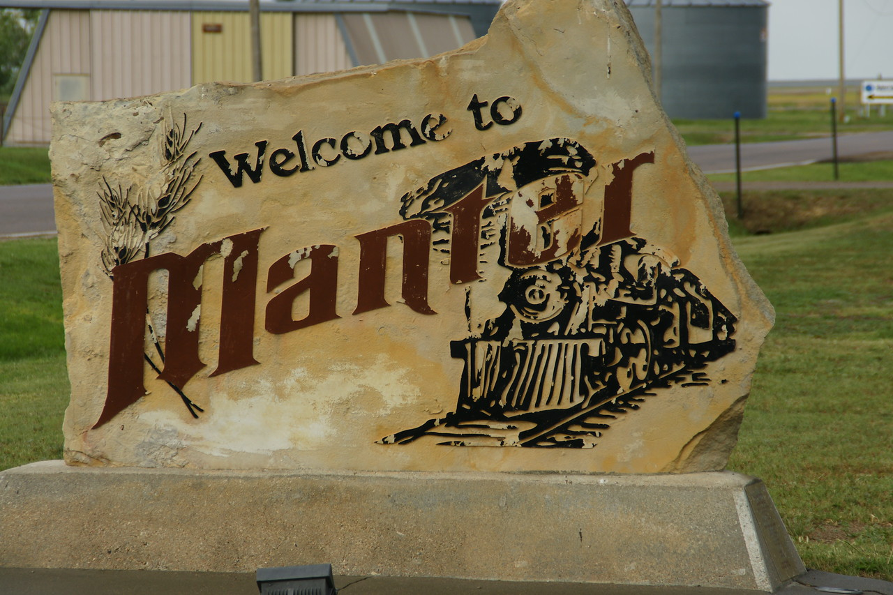Limestone welcome sign in Manter