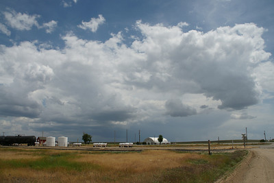 View of rain shower and cumulus clouds - western Stevens County