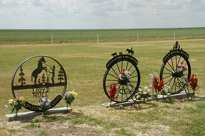 Unique wagon wheel monuments at Dermot Cemetery - northwest Stevens County