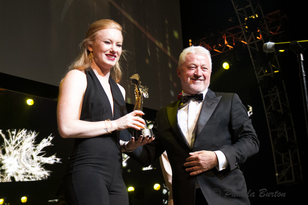 Keith Brackpool gives award to Best Amateur Jockey, Dina Heggum