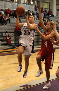 Darlington's #23 JennaMarie VanEs shooting over  Sonoraville's #4 Hannah Smith