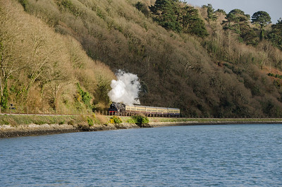 75014 heads alongside the River Dart as it approaches Britannia Crossing