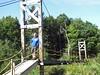 Nick on the bridge to Stoddard Cabin