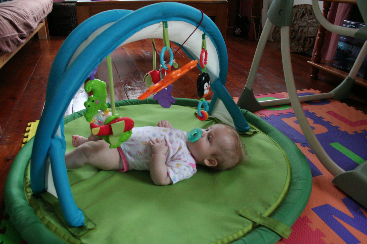 This is one of the TWO activity mats I have. I like to look at the really cute baby in the mirror...