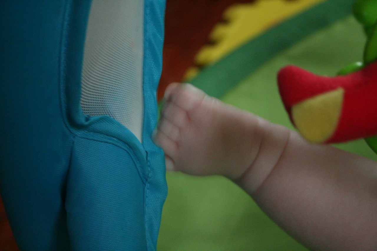 and grab things with my feet (mommy and daddy call these my monkey toes)
