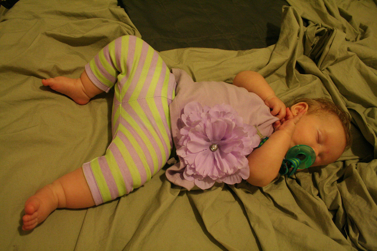 My striped tights, big flower outfit provided by Auntie Barb and Uncle Dave. Looks good even when I'm sleeping.