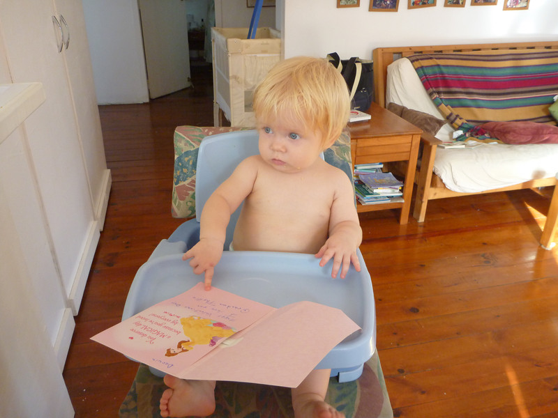Enjoying her singing birthday card from Grandma Lee