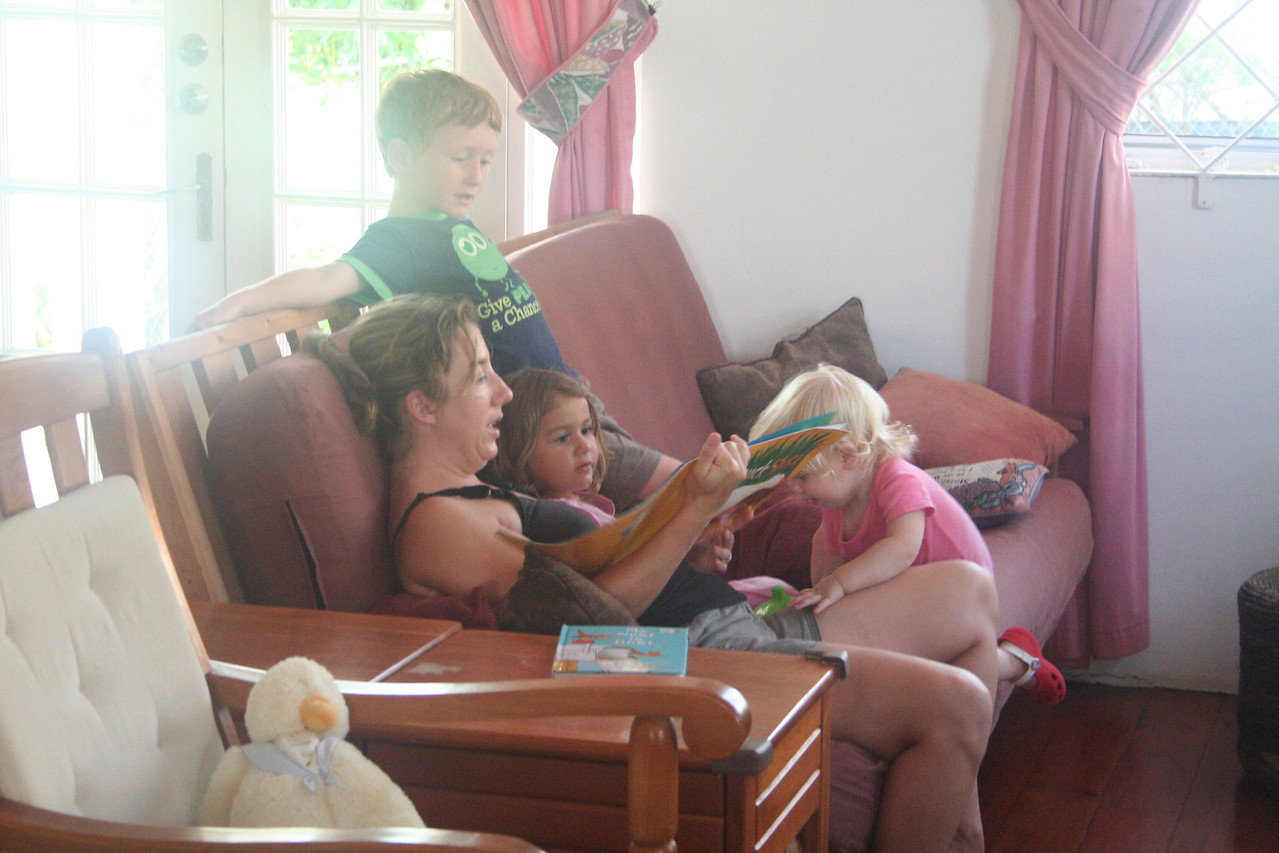 Reading books with Darwin and our neighbor's kids, William and Bella