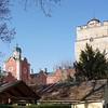 1546 erwarb Graf Leonhard IV. von Harrach die Herrschaft über Bruck an der Leitha. Von diesem Zeitpunkt an lebte die Stadt bis ins 19. Jahrhundert unter diesem Adelsgeschlecht. Die Burg Prugg blieb durch einen Schutzbrief von Kara Mustafa Pascha bei der Zweiten Türkenbelagerung 1683 verschont. Aloys Thomas Graf Harrach ließ sie von 1707 bis 1711 von Johann Lukas von Hildebrandt zu dem auch heute noch benutzten barocken Schloss Prugg ausbauen. Von 1854 bis 1858 erhielt das Schloss den neugotischen Tudorstil durch den englischen Architekten Charles Buckton Lamb. Mitte des 19. Jahrhunderts wurden auch das romantische Tor und das neugotische Haus des Parkaufsehers errichtet. Die Anlage wirkt jedoch etwas desolat.