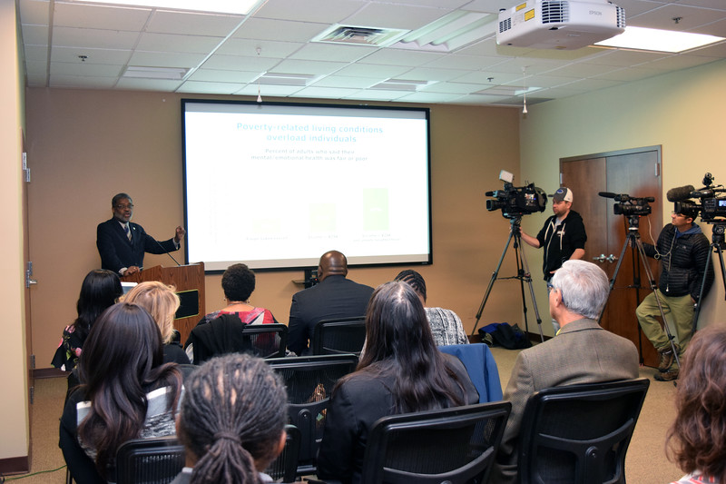Wade Norwood, CEO of Common Ground Health, speaks at a Nov. 18, 2019, press conference about how poverty-related living conditions overload low-income people in the Finger Lakes region.