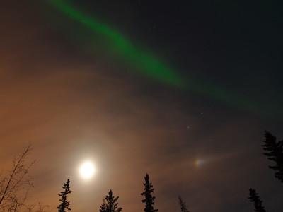 Moon, moon dog, and aurora