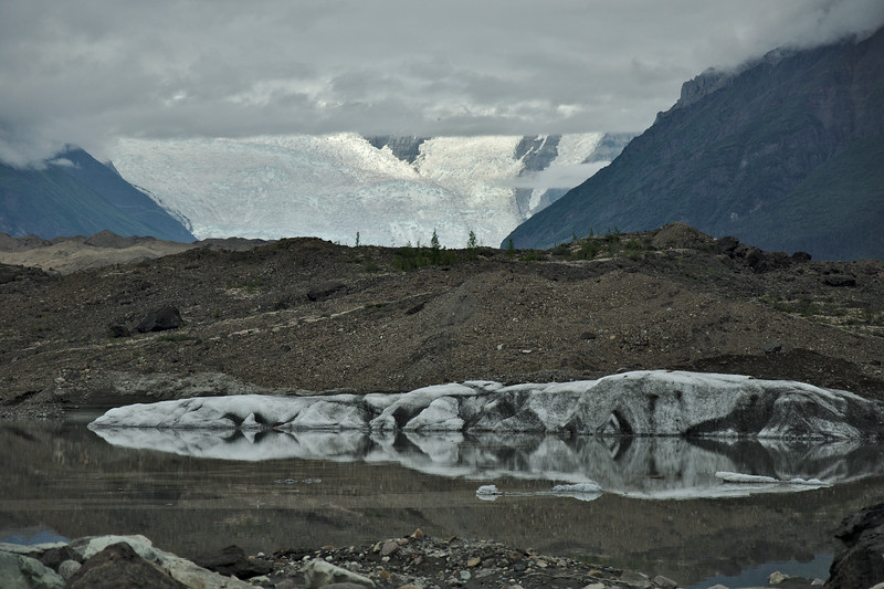 A small pond at the terminus of the glacier. There's a lot of debris covering the lower stretch of the glacier and it is slightly vegetated. Those icefalls are the 3rd largest in the world, and from this view are about 15 miles away.