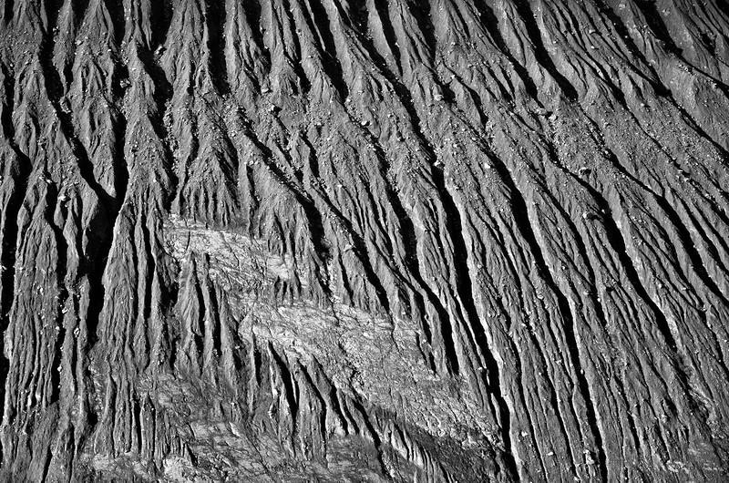 The erosion patterns in the mountainside interrupted by a single piece of solid rock in the mountainside made for some interesting contrast.