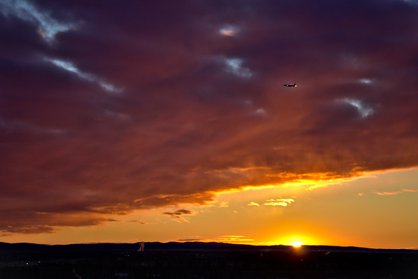 Watching the sunrise from in front of the Museum of the North at the University of Alaska Fairbanks. Just as the Sun crested over the horizon a bit of a light pillar appeared, coupled with a thin spot in the clouds, and a well-timed Alaska Airlines flight all made for a cool scene.