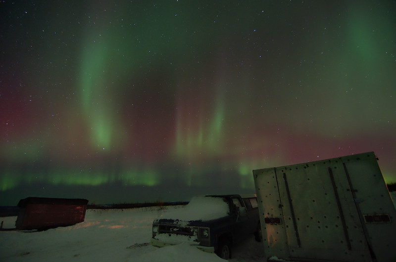 Taken in the winter of 2012 on Murphy Dome. I definitely drove our car into a snow bank on this lovely evening. Luckily the aurora stayed out long enough that even after all the digging, flagging down cars, and towing the car out of a ditch we still were able to watch the show.