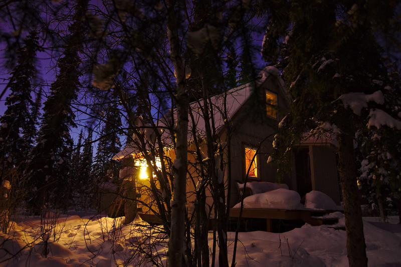 Our little dry cabin (no running water) in the winter twilight. Fairbanks, Alaska