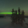 Aurora just off the horizon and a few satellites flying by. This was taken on Murphy Dome in March 2012.