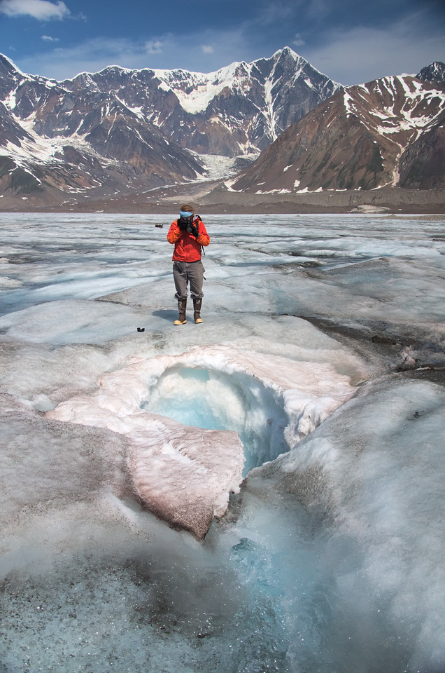 Staring down a moulin - the water must go somewhere! How about a 1500 ft. ride to the bottom of the glacier.
