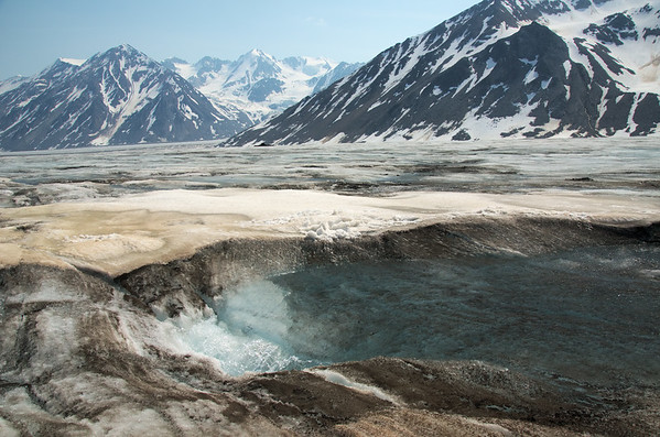 Surface water disappears in a thin crack.